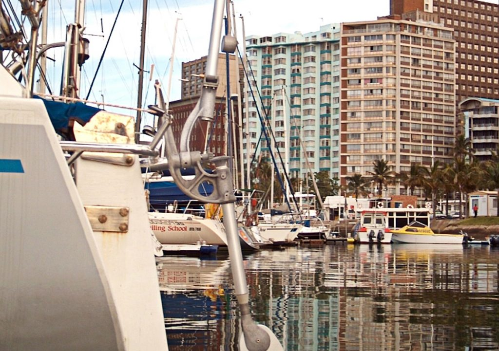 Yacht on moorings in Durban with a Neptune self steering windvane mounted on the stern
