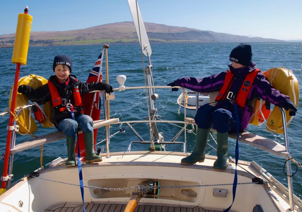 Kids enjoying a days sailing onboard a yacht with a Neptune self steering windvane