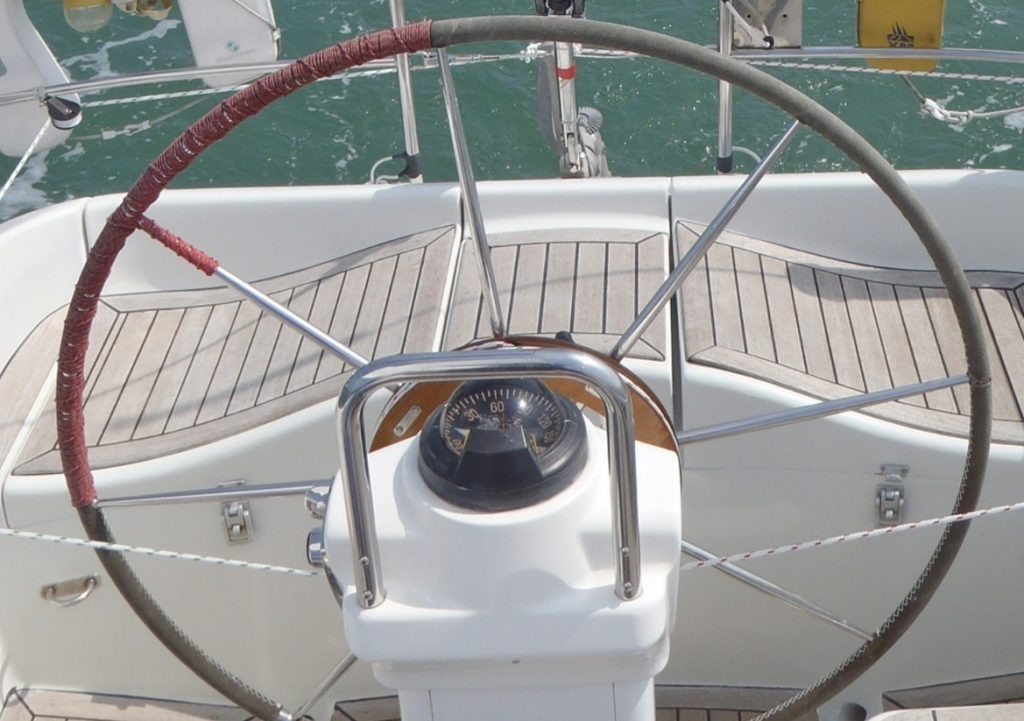 A sailboat fitted with a Neptune self steering windvane to the steering wheel